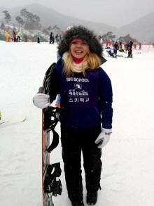 Nicole's ski clothes are almost bigger than she is.