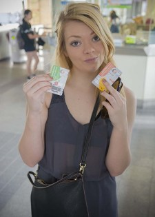 Nicole modeling our Skytrain tickets at the station.
