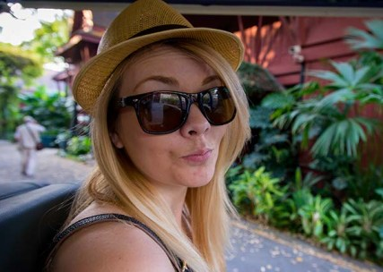 Nicole on the golf cart leaving the Jim Thompson House