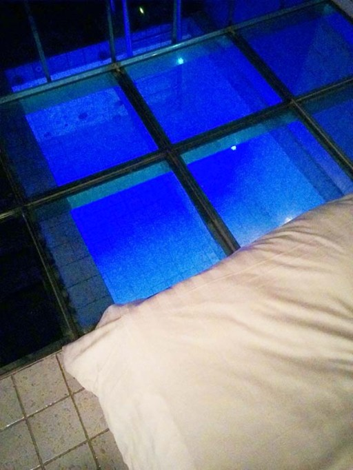 A view of the pool from the edge of the bed