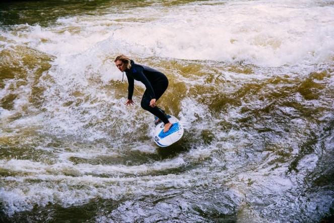 Surfing on the Eisbach river in the Englischer Garten