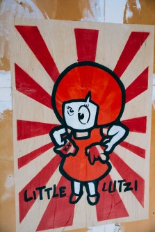 Little Lutzi and her cat used to be characters in cartoon about communist Germany, today there's lots of street art of her killing her cat in different ways