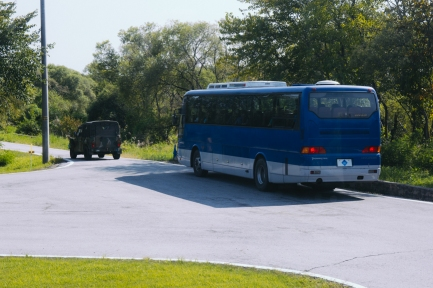 Our DMZ bus and military escort