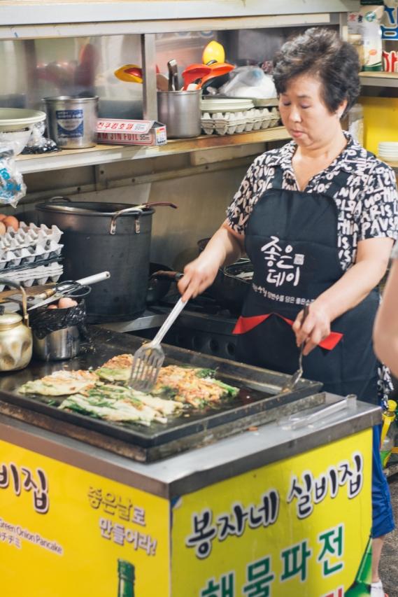 An Agjima making Jeon, Korean pancake