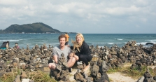 Sitting by some cairns